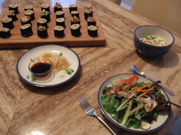 Raw vegan sushi served with miso soup, salad, organic pickled ginger and tamari.